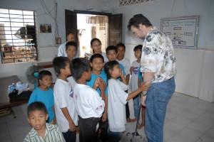 Elder Shafer visits with the children after worship.